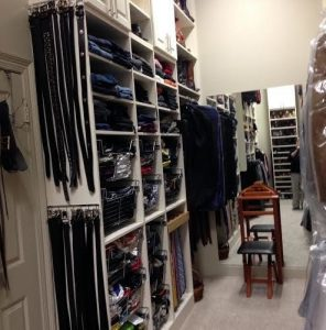 Hanging belts, slide rails for ties and baskets for socks and underwear make this man's closet tidy and easily accessible in a hurry.