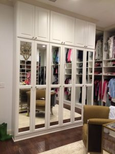 Mirrored cabinets make the space appear larger and provide a way for the owner to model their outfit!